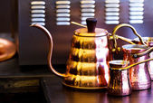 Copper set of kettle and turks — Stock Photo