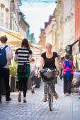 Woman riding bicycle in city center. — Stock Photo