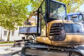 Excavator loading dumper truck. — Stock Photo