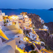 Oia village on Santorini in sunset, Greece. — Stock Photo