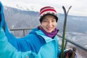 Female skier taking selfie. — Stock Photo