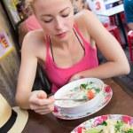 ������, ������: Traveler eating traditional thai Tom Yum soup