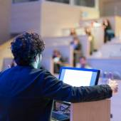 Speaker giving talk on podium at Business Conference. — Stock Photo