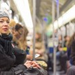 Woman traveling by subway full of people. — Stock Photo #76020481