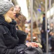 Woman traveling by subway full of people. — Stock Photo #76020569