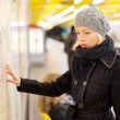 Lady looking on public transport map panel. — Stock Photo #76863465