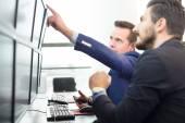 Stock traders looking at computer screens. — Stock Photo