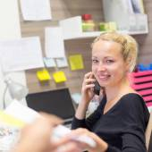 Businesswoman talking on mobile phone in office. — Stock Photo