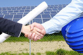 Solar panel handshake — Stockfoto