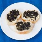 3 sandwiches with black caviar — Stock Photo #65722685