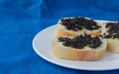 3 sandwiches with black caviar — ストック写真
