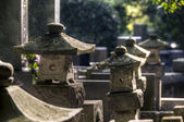 Japanese cemetery with stone lanterns — Stock Photo