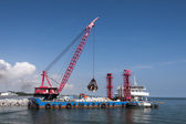 Industrial floating sea crane — Stock Photo