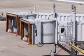 Jet bridges waiting for airplane at airport — Stock Photo