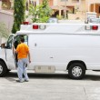 White ambulance with the driver getting out to help the paramedi — Stock Photo #52622653