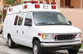 Side part of a white ambulance — Stock Photo