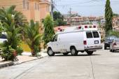 Ambulance entering to a house — Stock Photo