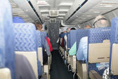 Passengers sleeping with low lights in the flight of the plane — Stock Photo