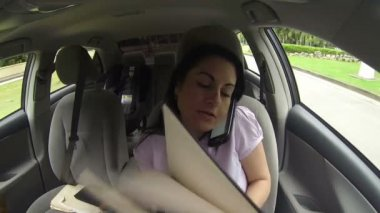Businesswoman working in the car — Stock Video