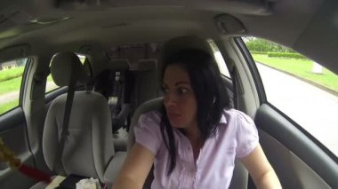 Gorgeous woman driver looking back and parking car — Stock Video
