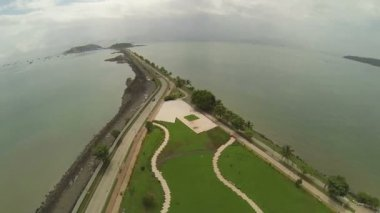 Aerial View of Amador Causeway, the Pacific entrance to the Panama Canal, Panama, Central America. A one-lane road runs along the causeway to each island, and there is a bicycle, jogging path as well. — Stock Video