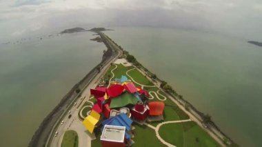 PANAMA CITY PANAMA NOVEMBER 5: Aerial view of Frank Gehry's Museum of Biodiversity on november 5 2014 in Panama City, Panama. The Biomuseo is his only work in Latin America and the tropics. — Stock Video