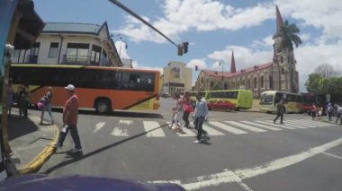 SAN JOSE, COSTA RICA - MAY 6: POV of traffic jam along the Avenida Central where the Iglesia De La Merced is located towards the city centre on May 6, 2015 — Stock Video