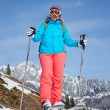 Middle Aged Woman On Ski Holiday In Mountains — Stock Photo #55437771
