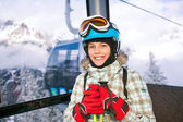 Happy skier girl on ski lift. — Stock Photo
