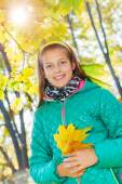 Cute girl with autumn leaves — Foto Stock