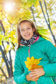 Cute girl with autumn leaves — Стоковое фото