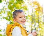 Cute boy with autumn leaves — Stock Photo