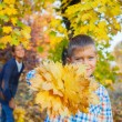 Cute boy with autumn leaves — Stock Photo #56525007