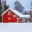 Red wooden Finnish house — Stock Photo #61742183