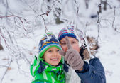 Winter boy with mother — Stock Photo
