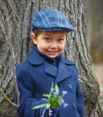 Boy in spring forest — Stock Photo