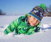 Little boy in winter park — Stock Photo