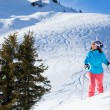 Woman On Ski Holiday In Mountains — Stock Photo #65546635