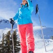 Woman On Ski Holiday In Mountains — Stock Photo #65546683
