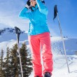 Woman On Ski Holiday In Mountains — Stock Photo #65546759