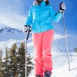 Woman On Ski Holiday In Mountains — Stock Photo #65546843