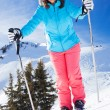 Woman On Ski Holiday In Mountains — Stock Photo #65546893
