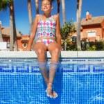 Girl in the pool — Stock Photo #67544995