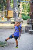 Boy in a climbing adventure park — Stock Photo