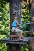 Girl in a climbing adventure park — Stock Photo