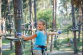 Girl in a climbing adventure park — Stok fotoğraf
