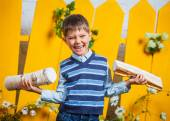Boy with pile of firewood — Stock Photo
