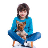 Boy with his Yorkshire terrier — Stock Photo