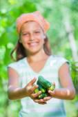 Girl with cucumbers — Stock Photo