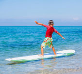 Boy with surf — Stock Photo